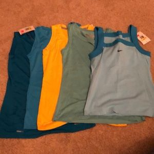 5 Nike tops. 4 NWT and 1 new without tags.